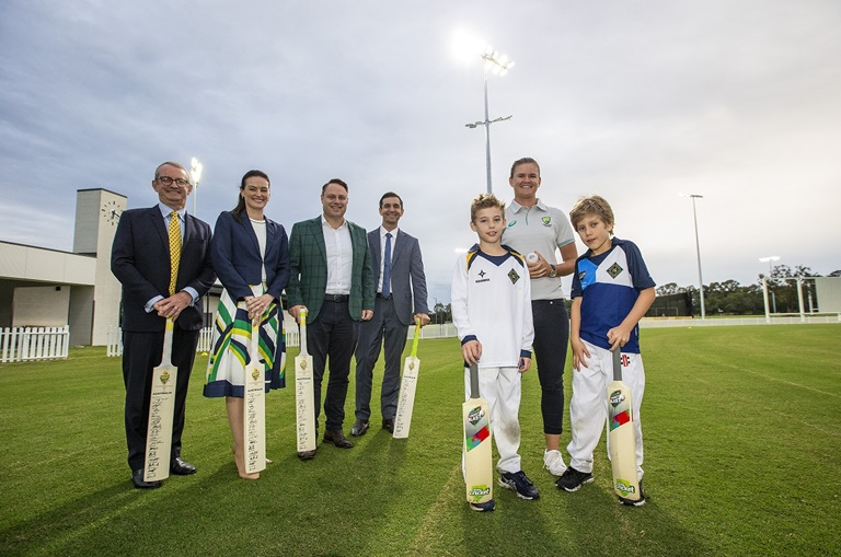 Queensland and Australian player Jess Jonassen with youth players and political representatives at the NCC opening.